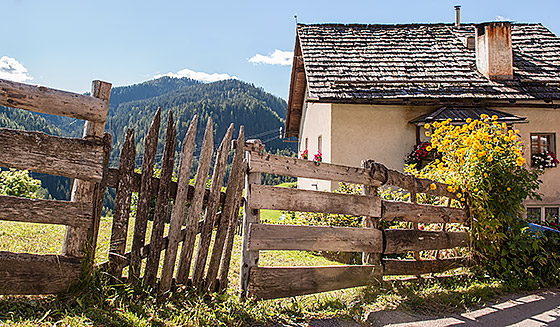 A fence and house in the village of La Valle