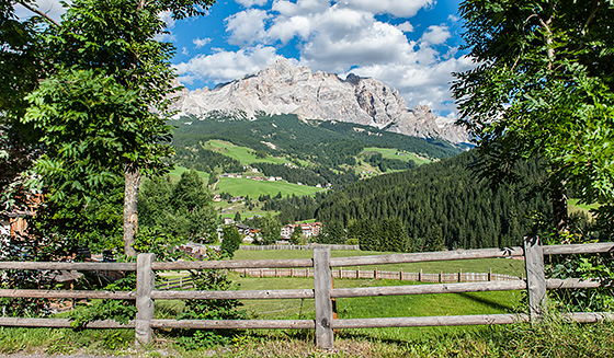 A Fence and, beyond, one glimpse of the mountains of Alta Badia