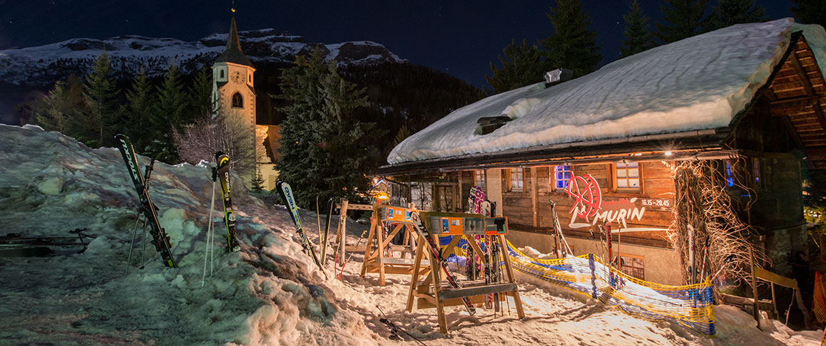 A house illuminated in winter in Corvara