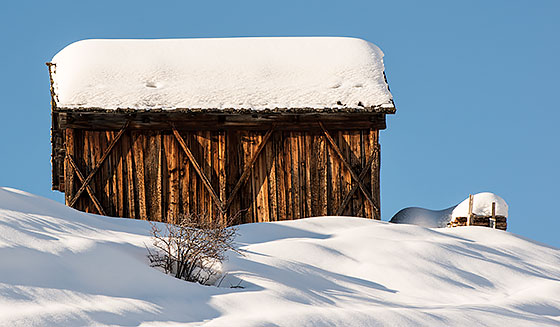 View of a snowy wooden house