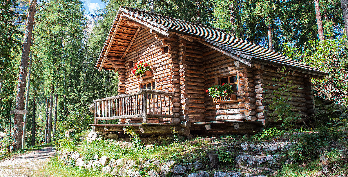 A little house made with wood logs in the woods
