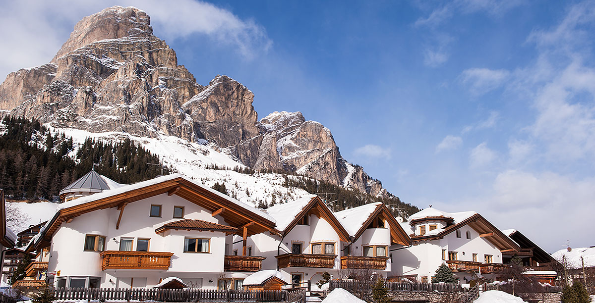 Houses of the village of Corvara in snowy winter