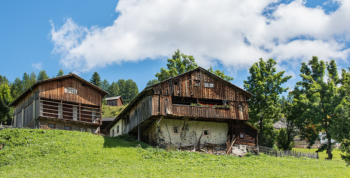 Ancient houses in wood and stone typical of Ladin culture