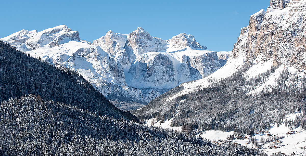 Snowy mountains and lush forests with trees in Alta Badia