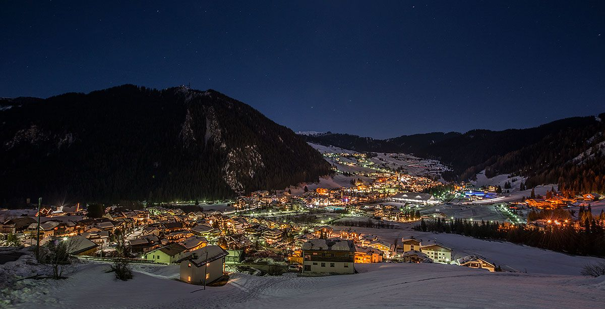 A country of Alta Badia covered with snow with bright lights