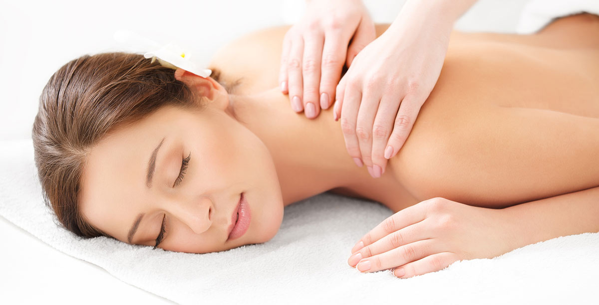 Woman relaxes during a massage